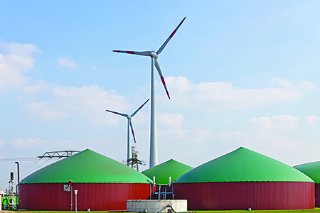 Biogas digester next to wind farm